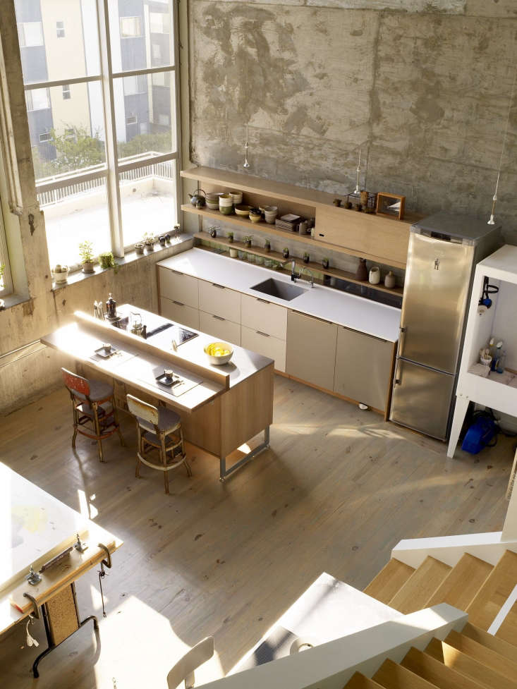 the kitchen anchors one end of the loft&#8\2\17;s large, open floor plan. 19