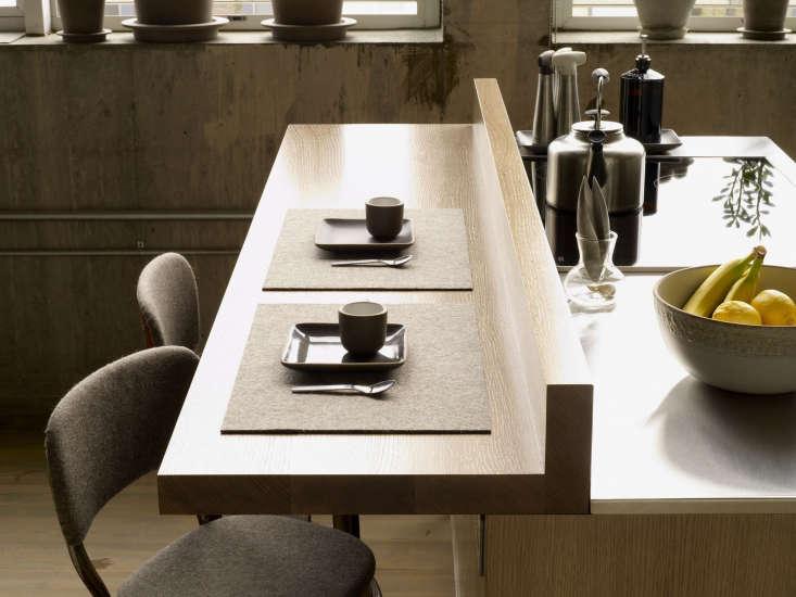 the breakfast bar is solid white oak, cantilevered using hidden metal brackets. 17