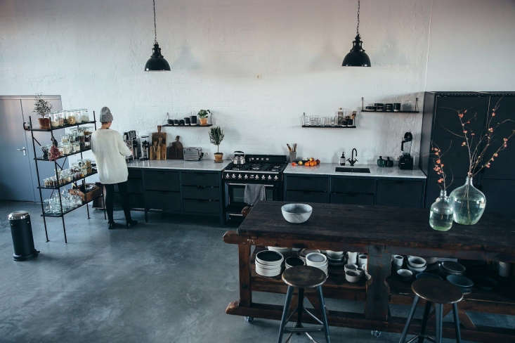 For their kitchen island, Nora and Laura selected a large, old workbench that, like most of the vintage pieces in the loft, came fromJ & V,their favorite Berlin salvage shop.