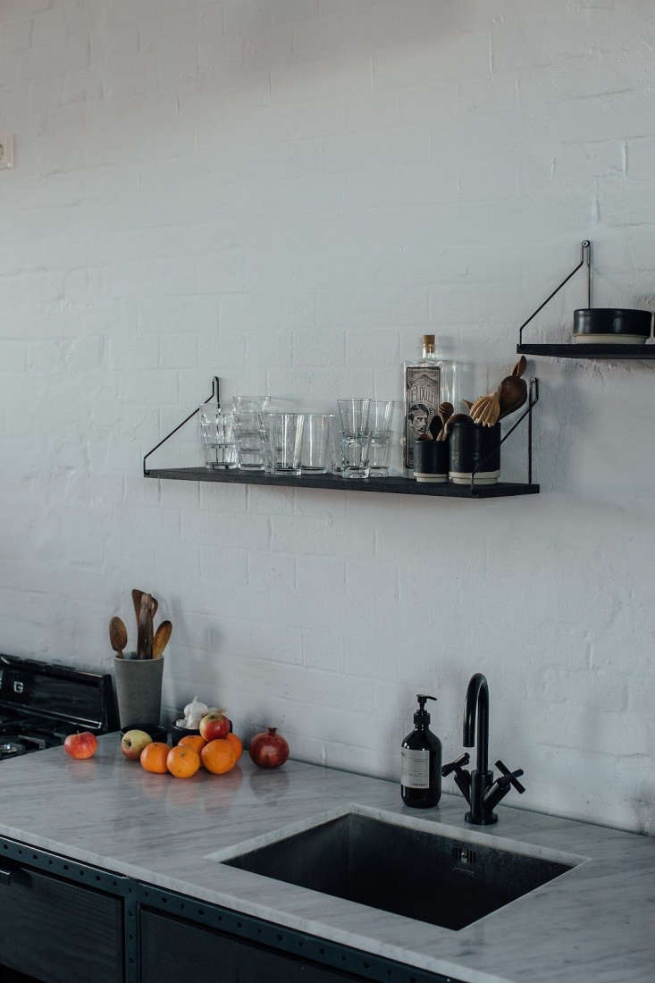 The counters are made of white Portuguese marble andthe matte black faucet is Dornbracht&#8