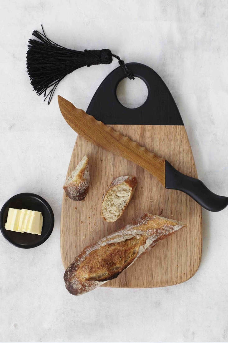 The Ana Cheese Board has black lacquer detailing and a tassel.