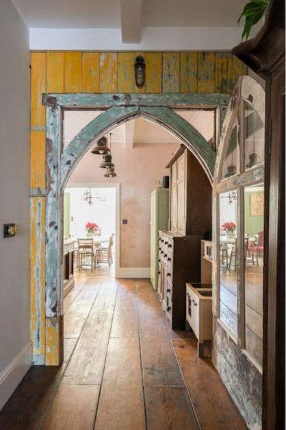 salvaged wood paneling and church archway in a renovated london victorian house 15
