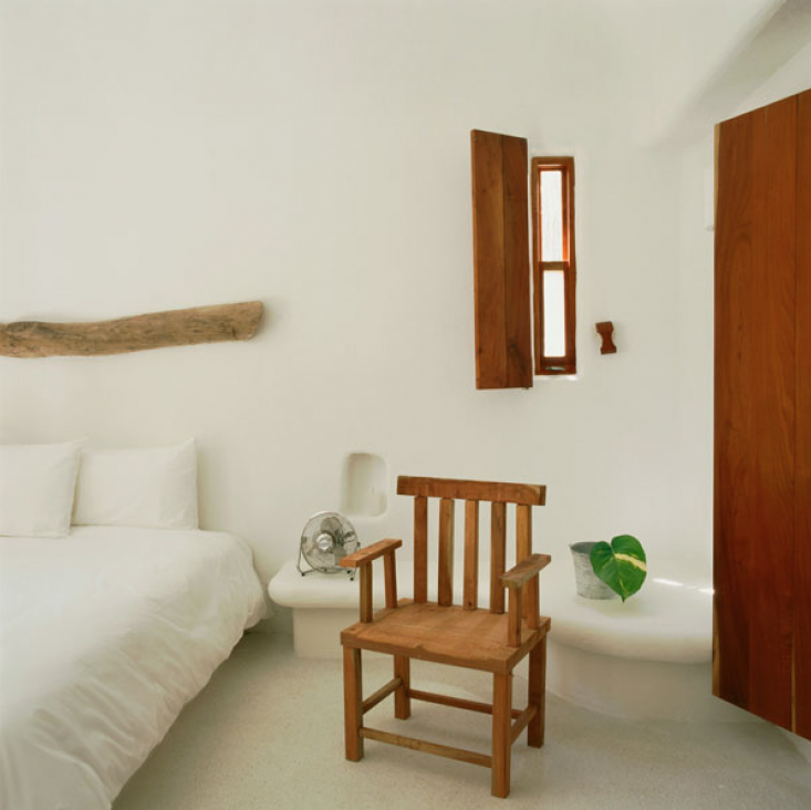 Also at the Hotel Azucar, sculptural stone nightstands are built into the wall.