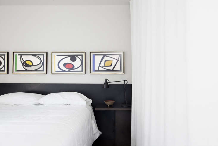 bedroom modern artwork above bed white curtains