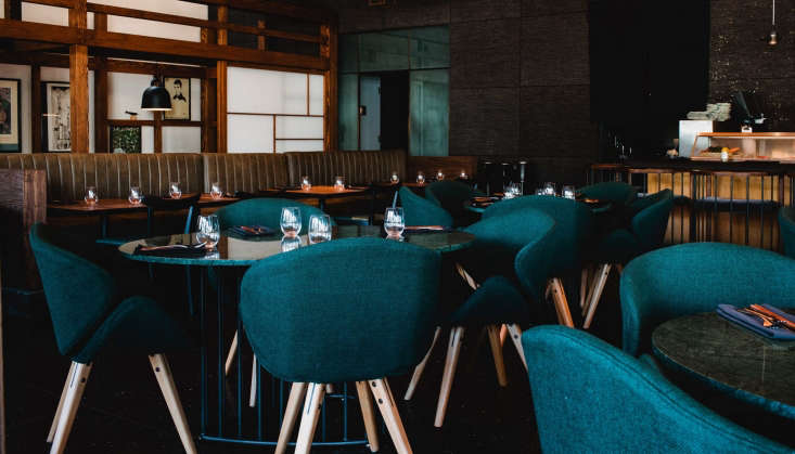 Chaya Venice A Landmark LA Restaurant Redesigned for the Modern Era Upholstered chairs surround round tables in a more formal part of the dining room.