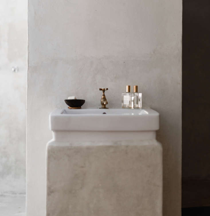 A simple porcelain basin is sculpted into a pillar of Tadelakt plaster at Coqui Coqui, in the ancient Mayan city of Coba. Photograph by Cerruti Draime from Bathroom of the Week: The Serene and Sculptural Coqui Coqui Bath.