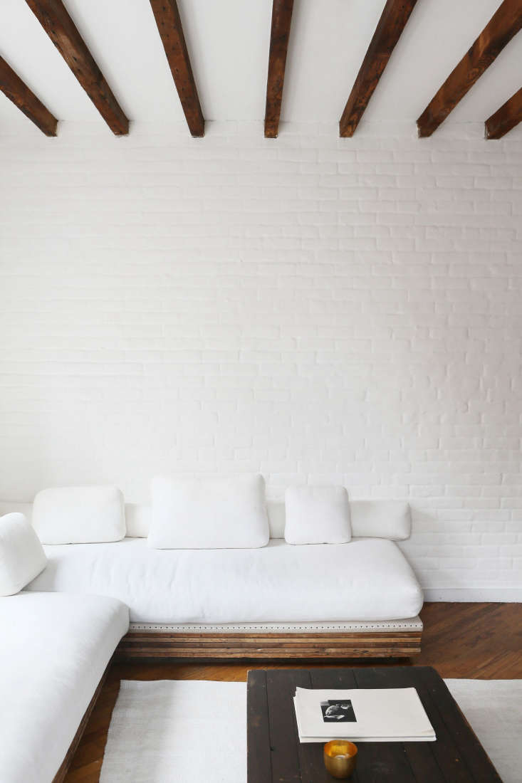 Javitch painted the brick walls with several coats of white paint &#8