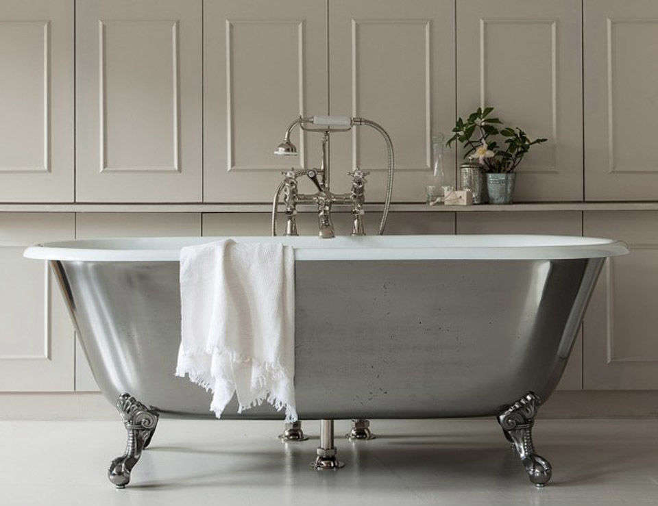 10 Easy Pieces Silver Finish Freestanding Bathtubs The Swale Bathtub with Ball & Claw Feet is shown in polished cast iron; \$8,\250 at Drummonds.