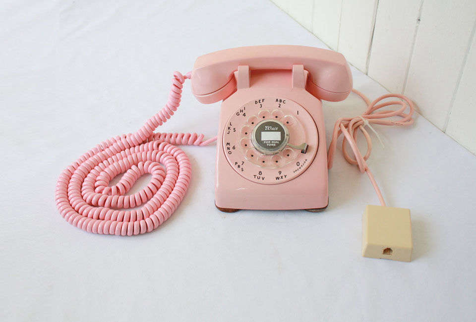 Source a vintage telephone like this Pink Rotary Phone on Etsy.