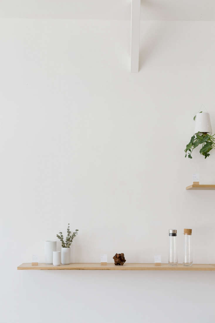 a shop shelf holds threelyngby vase (\$59to \$\1\19), awood puzzle by yam 13