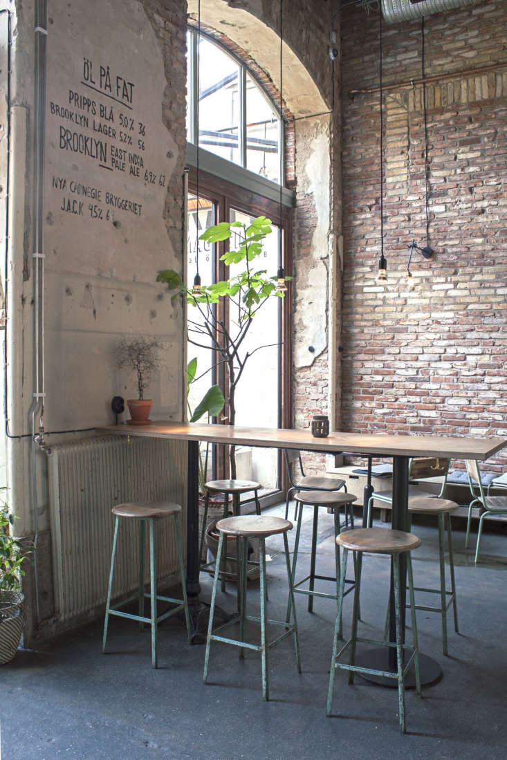 in keeping with the industrial feel, furnishings in the dining area are similar 14
