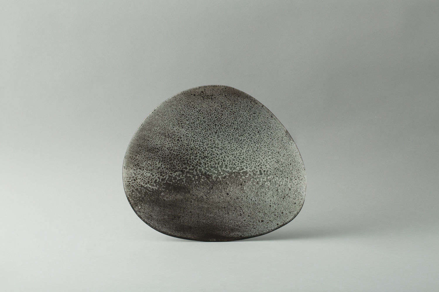 The Speckled Mirror, like the black mirror, has a textured and misshapen quality.