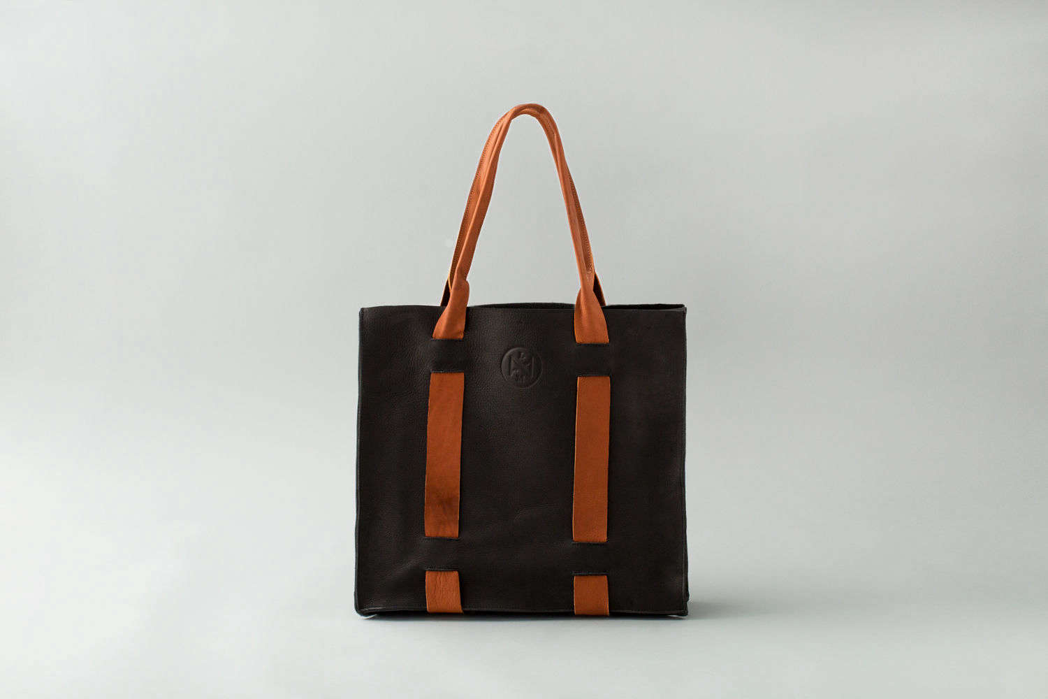 The Tote Bag is made completely of black and vegetable-tanned leather.