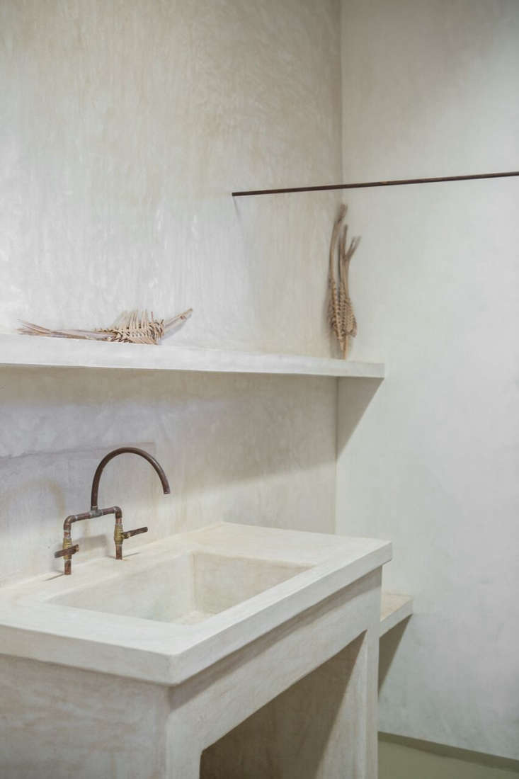 The bathroom faucets are made from copper pipe; for more ideas, see Trend Alert:  DIY Faucets Made from Plumbing Parts.