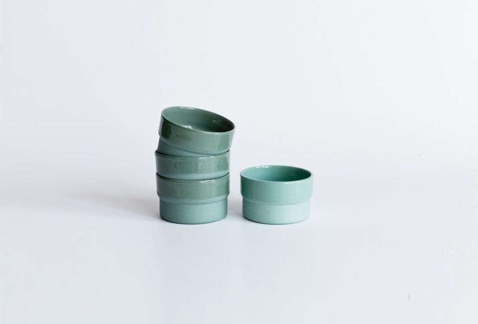 A stack of pastel Mr Right Cups by ceramicist Lenneke Wispelwey. The cups are £ ($30) at Smug.