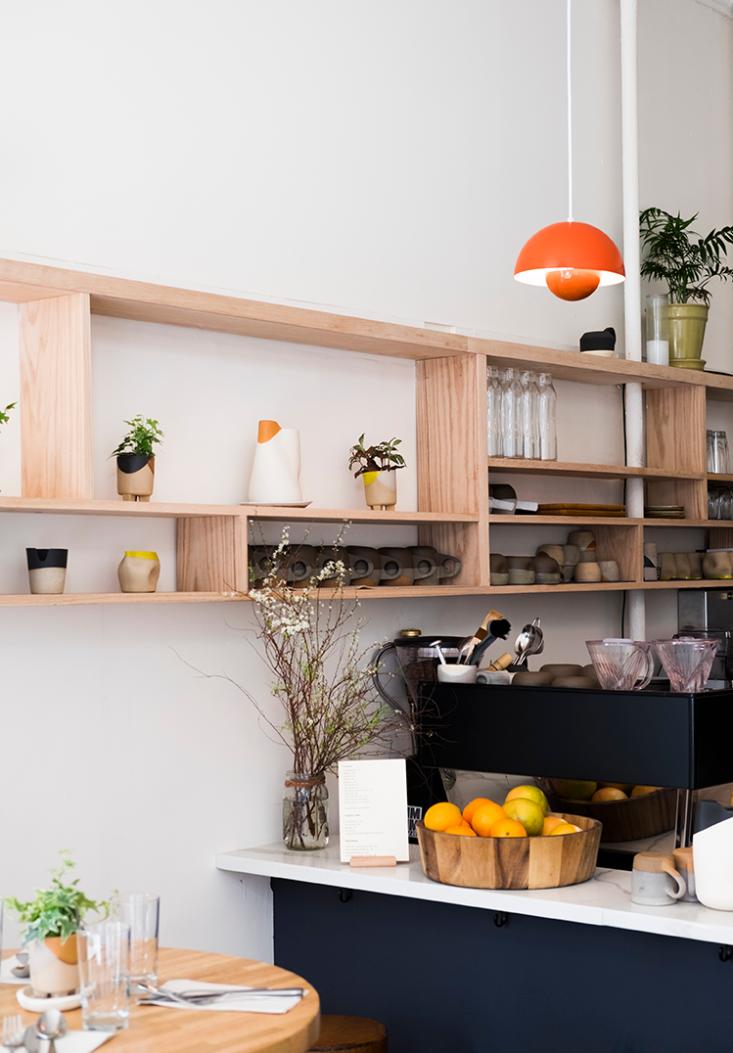 built in plywood shelves line one wall, and louis poulsen flower pot pendant li 10