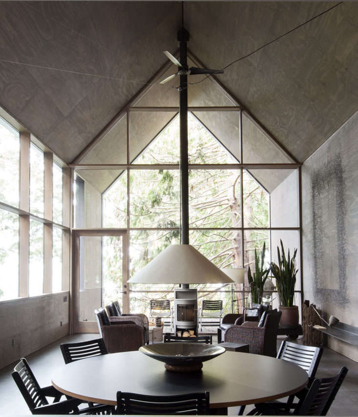 living room plywood walls ceilings round dining table