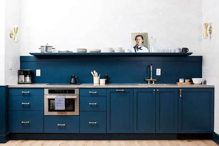 A kitchen in Philadelphia hotelLokalby Jersey Ice Cream Co., with cabinets painted in Sherwin Williams'sSeaworthy. See more inTrend Alert: The Cult of the Blue Kitchen.