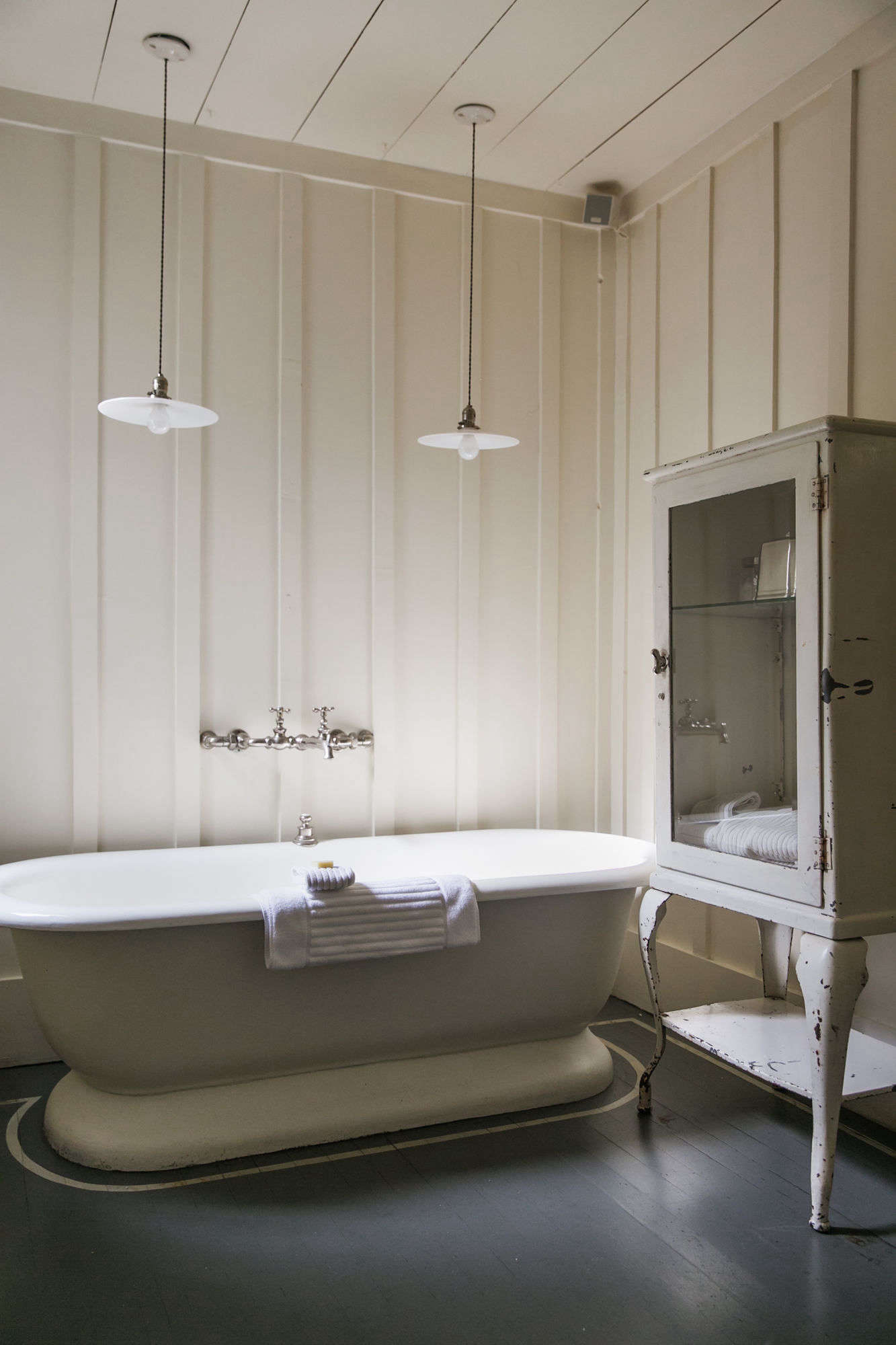 the paneled bath with vintage fixtures and furniture. 19