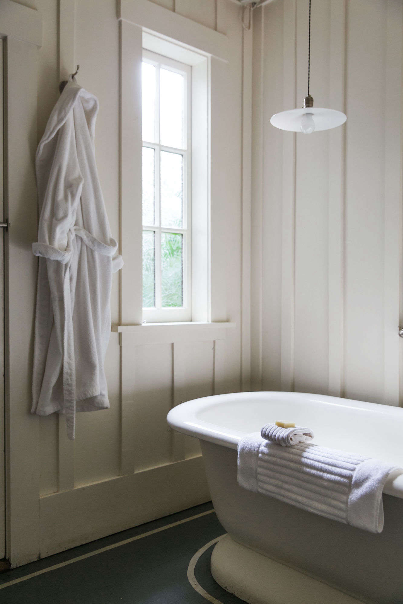 Weighty terry cloth robes and ribbed white towels make up the linens in the bath.Photograph by Andria Lo for Remodelista.