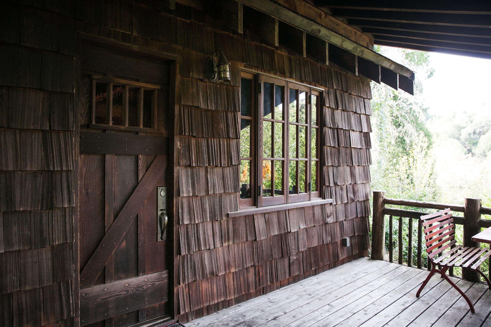 the rustic shingled entrance into manka&#8\2\17;s cabin. 14