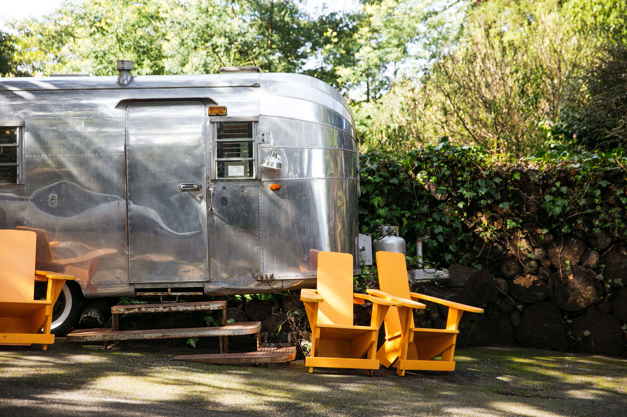 a large airstream trailer serves as an office and check in counter. 10