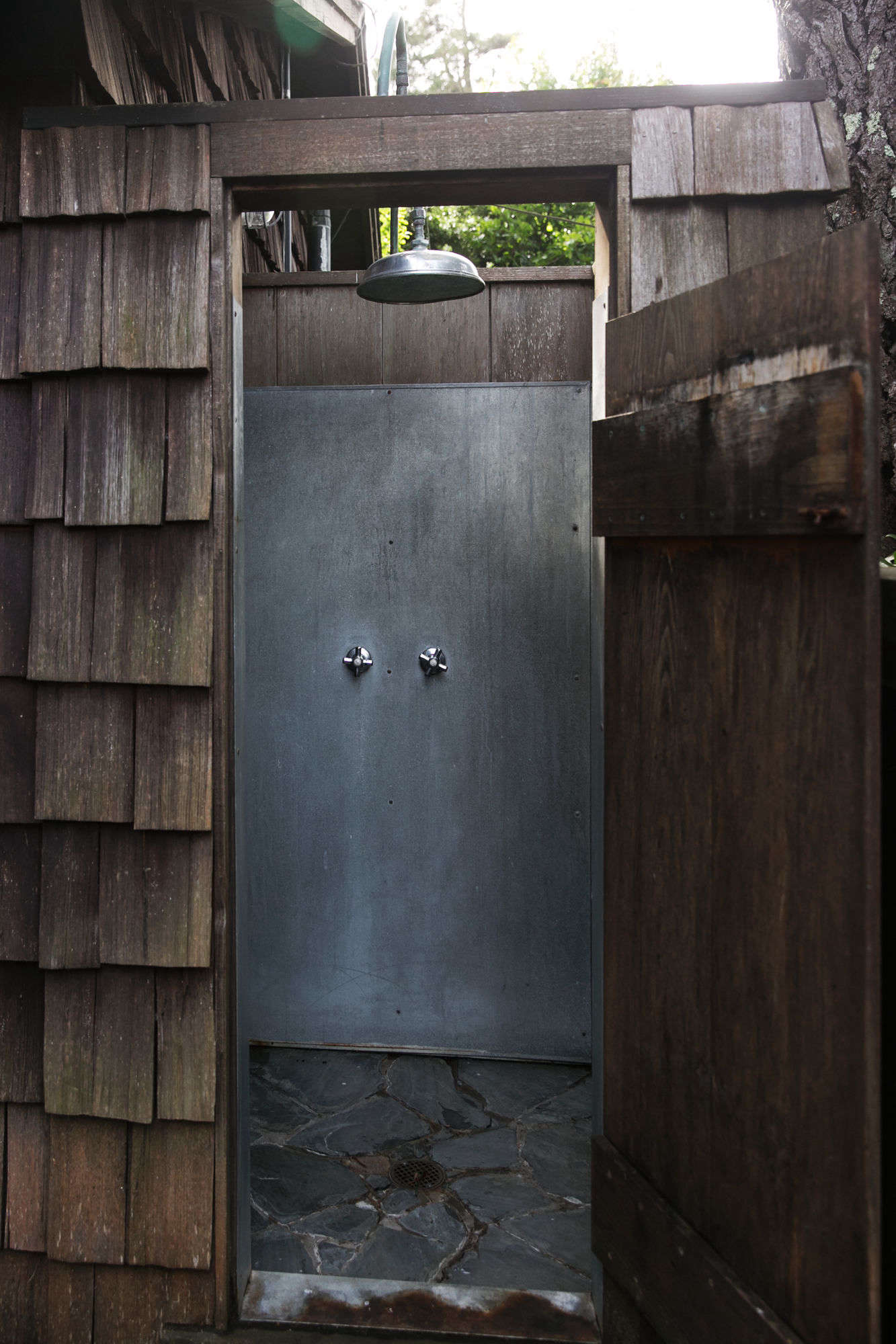 the outdoor shower enclosure opens from the bathroom onto the porch. 26