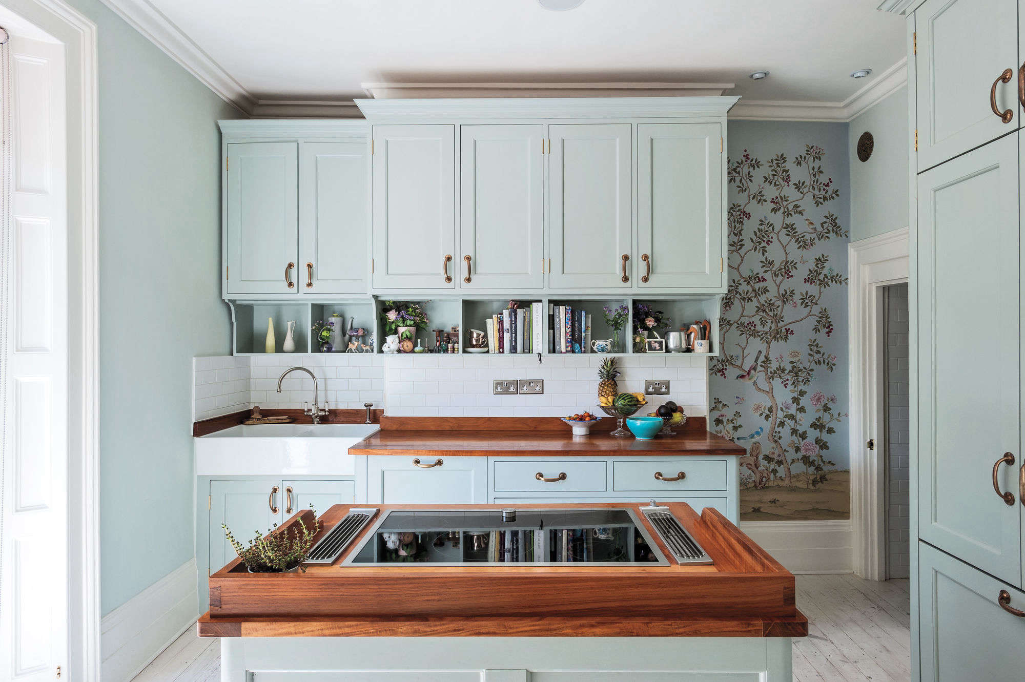 The Shaker cabinets, cooktop island, and cherry counters were designed and constructed by brothers Ben and Tim Goodingham. Photograph by Matthew Williams forRemodelista: A Manual for the Considered Home.