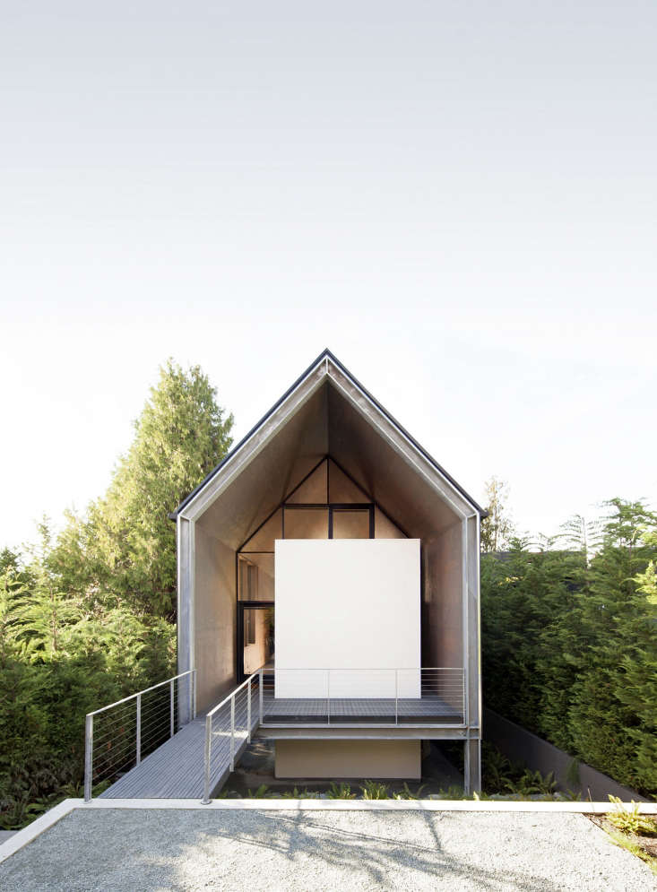 modern pitched roof small minimalist house in seattle forest