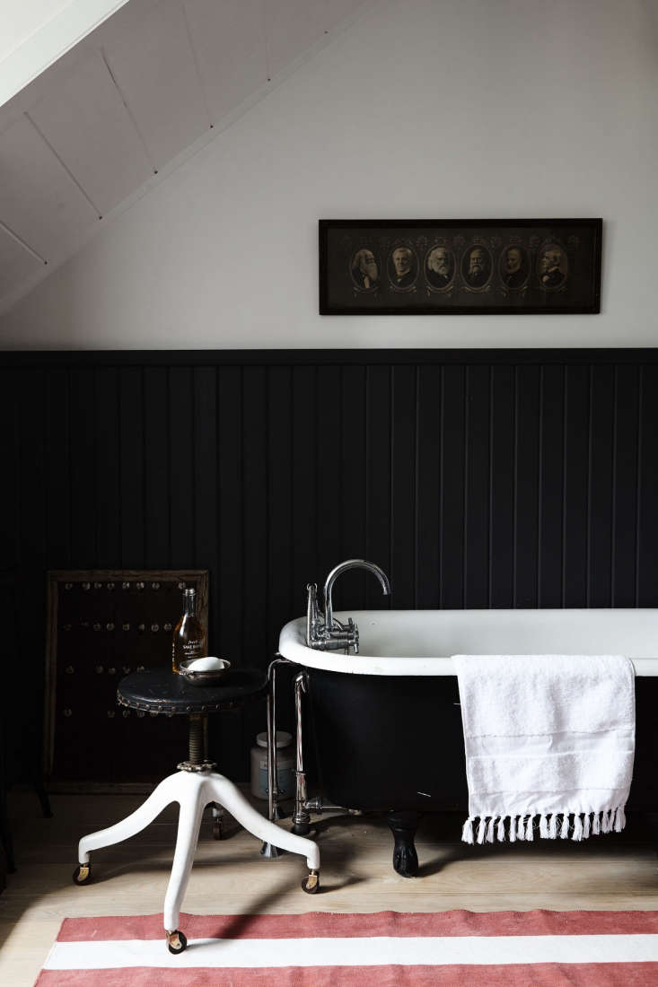 red and white stripes add drama to a black bath. photograph courtesy of nicole  10