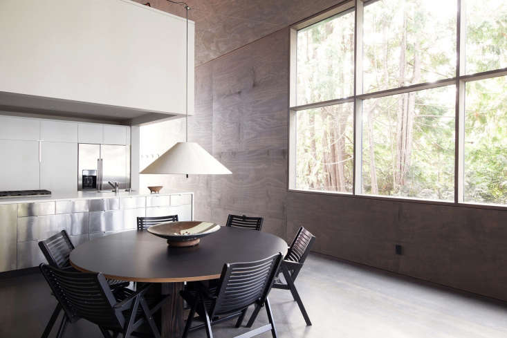 open dining kitchen plywood wall windows round table