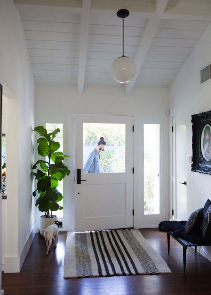 sarah and bogartthe dog in the entryway. bogart and penny (not  d) are quite  27