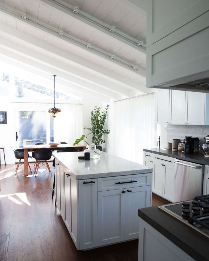 with a wall removed, the kitchen now leads directly into the dining room. the c 13
