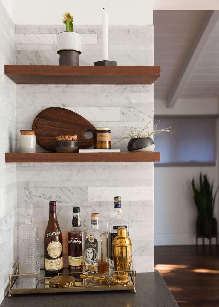 custom walnutshelvingbeside the oven transforms an awkward nook into a co 12
