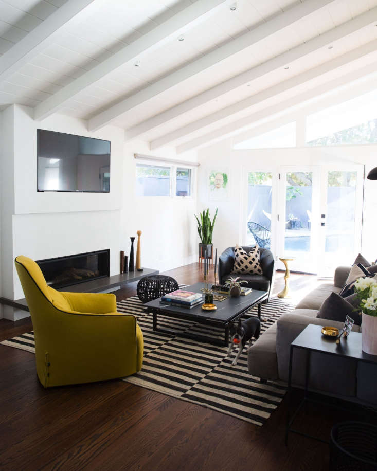 the living room with french doors leading to the pool is the most colorful spac 17