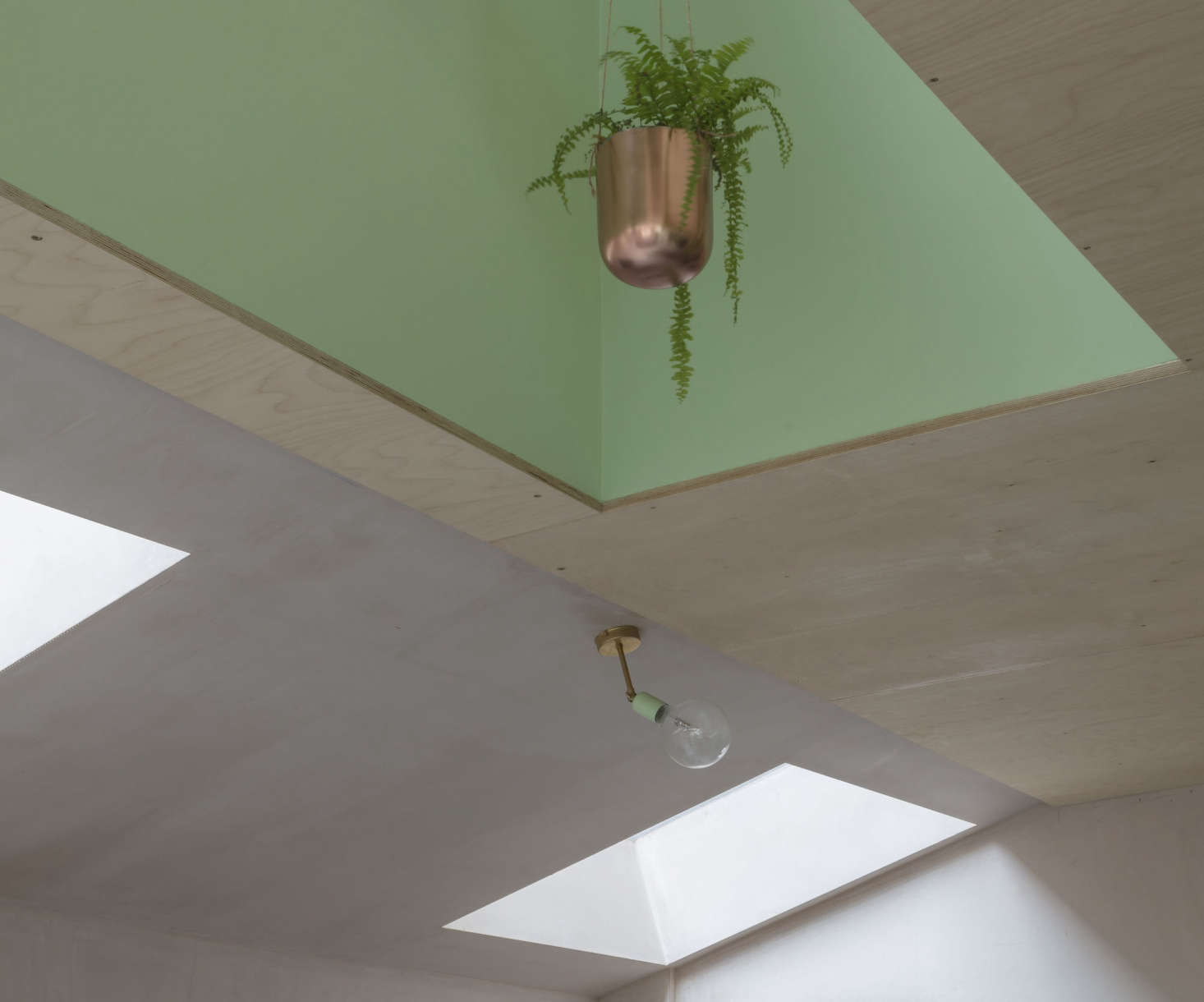 The family hung a series of copper planters in the recess over the island. For a similar design, consider Bloomingville&#8