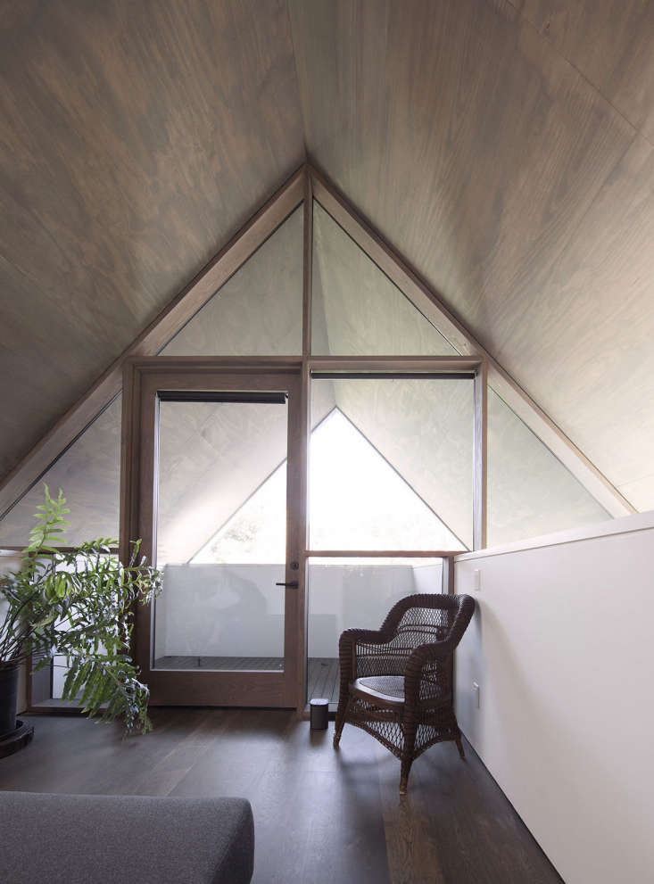 pitched roof plwyood walls seattle modern house window onto deck
