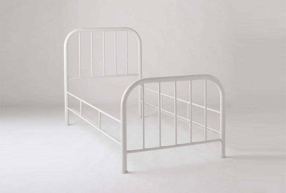 The Hamilton Bed, shown in Factory White, is inspired by early th century iron bed frames. It&#8
