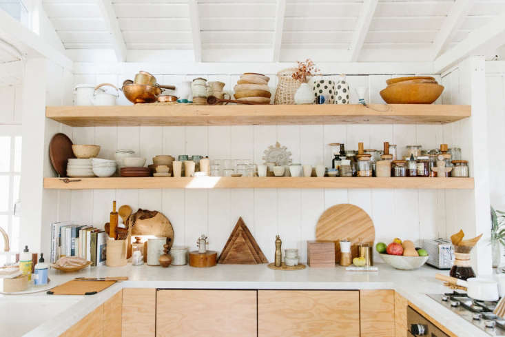 a brass, deck mounted faucet (just out of frame) and sturdywoodshelving add 10