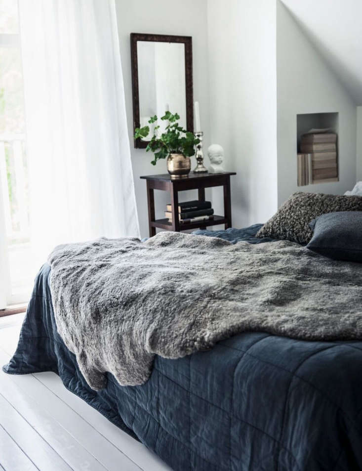 A Swedish sheepskin looks casually luxe when draped on a bed. SeeOut Like a Lamb: Scandi Sheepskins from Shepherd of Sweden.