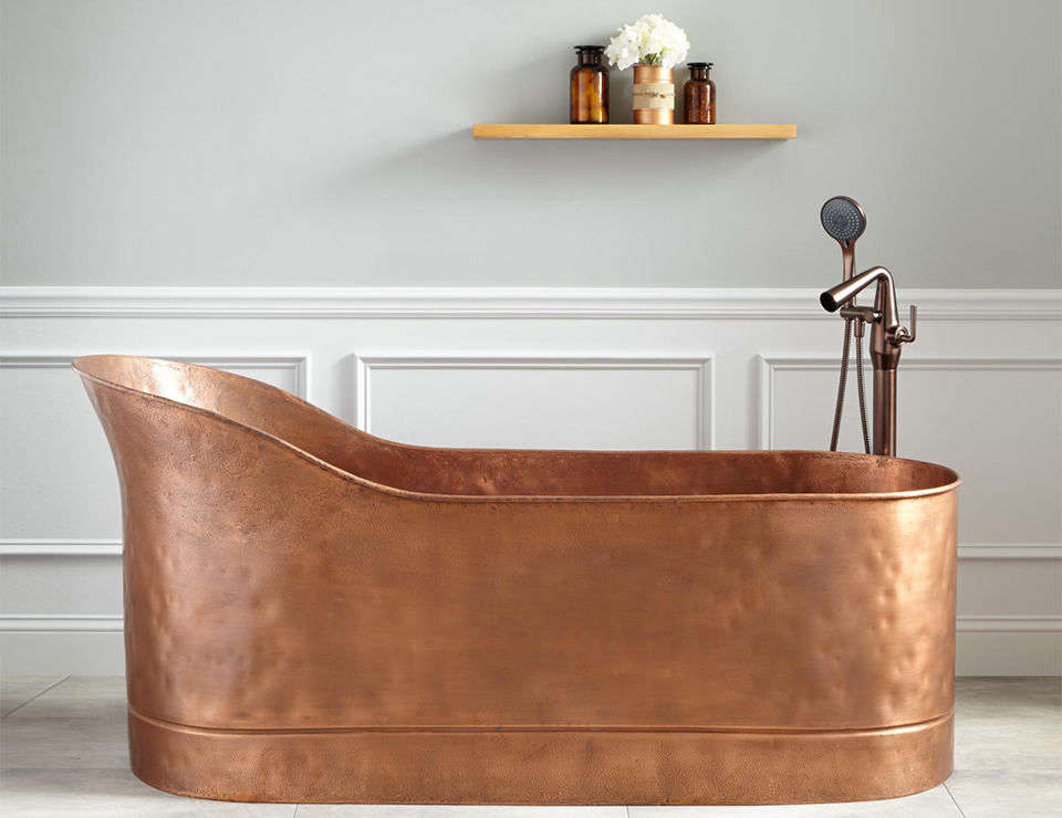 The Henrick 67-Inch Textured Copper Slipper Tub has a hammered copper texture inside and out and is finished with an antique copper patina; $