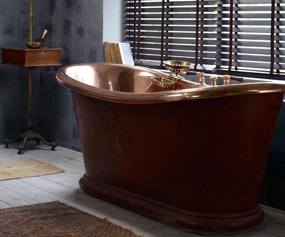 The Antique Copper Bath from the Water Monopoly is an actual th-century French double-ended tub; £6,695 ($8,0).