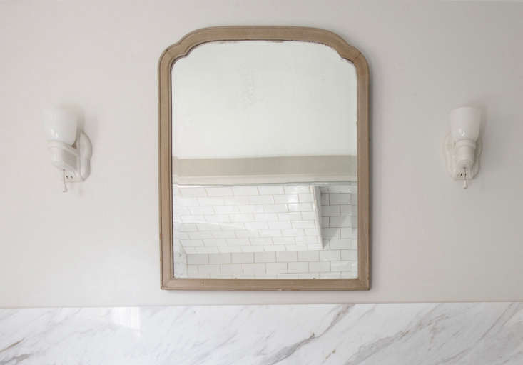the wood framed mirror was one of several found in the existing farmhouse; its  10