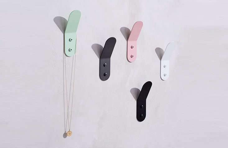 The low-profile Bent Metal Wall Hook by LA-based designer Eric Trine is available in five colors with matching screws;$ each via West Elm.