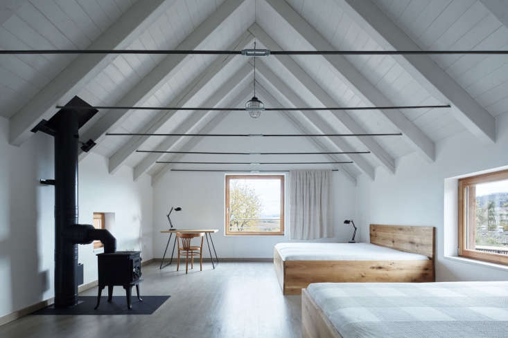 upstairs in one of the buildings is a quiet guest room with wooden platform bed 13