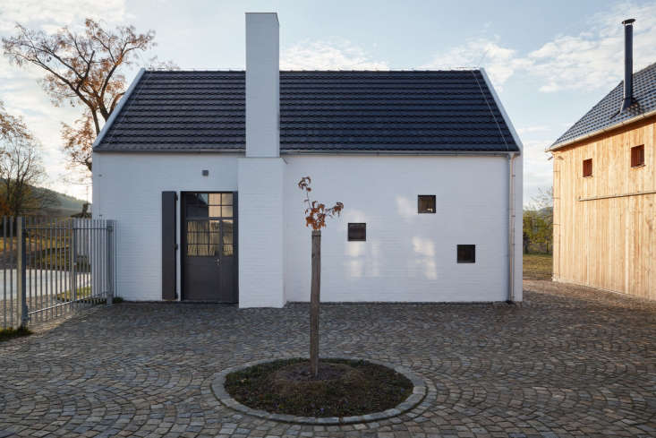the black shingled roof is a modern take on traditional czech roof tiles. 21