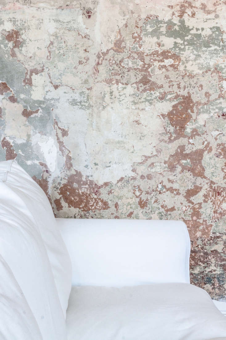 aged plaster scraped wallpaper walls italy apartment archiplan studio