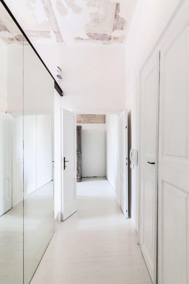 all white apartment hallway mirror closet archiplan studio
