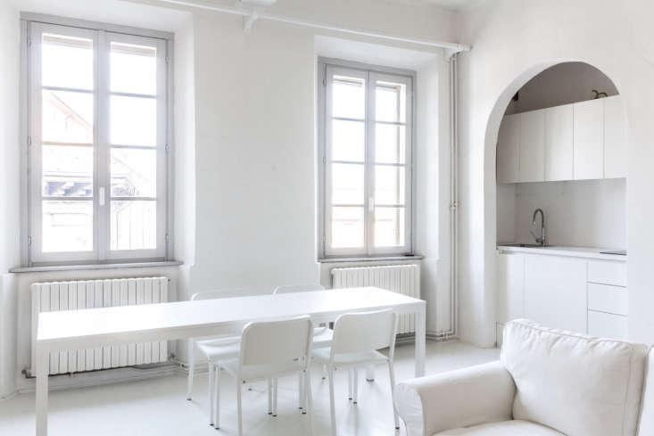 all white italian apartment living room long dining table archiplan studio