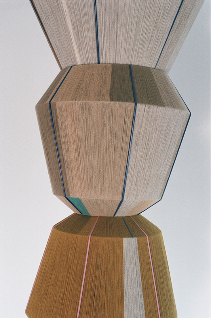 Atower of earth-toned Bonbon lamps. &#8